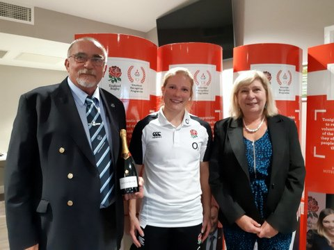 Lydia Thompson presents Mitsubishi Club Volunteer Award